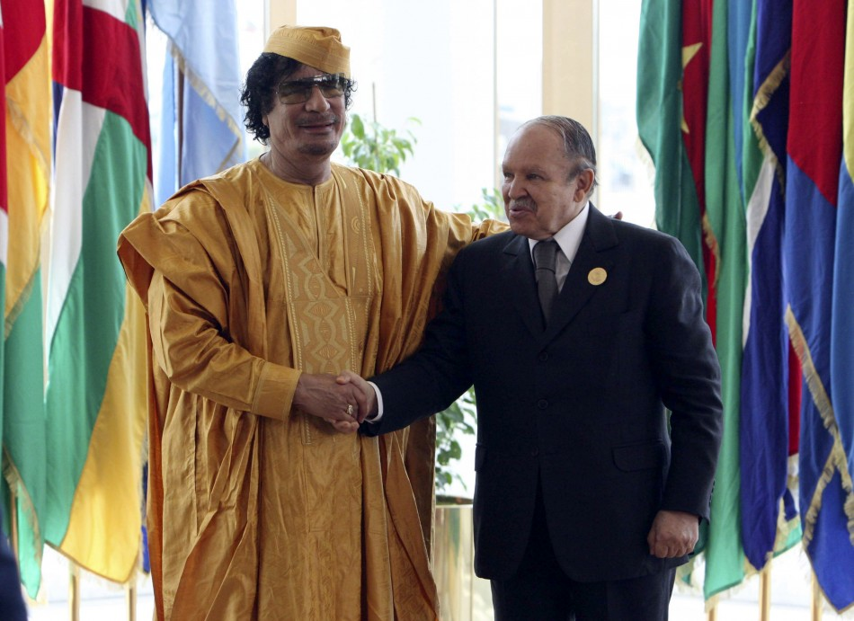 Libyan leader Gaddafi greets Algeria's President Bouteflika before opening of the African Union summit in Sirte