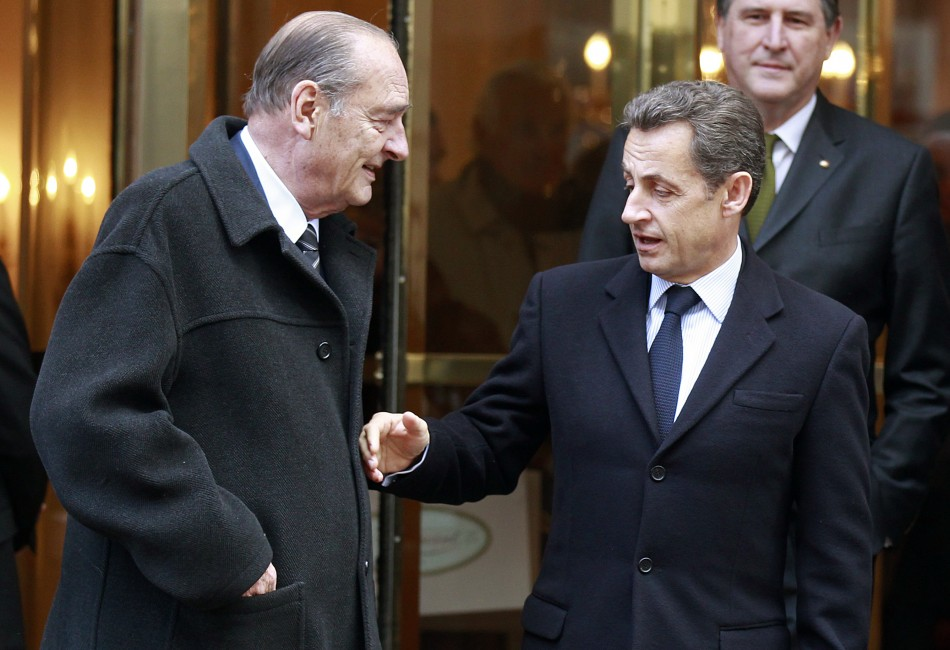 France's President Nicolas Sarkozy shakes hands with former president Jacques Chirac after lunch at Hotel in Paris