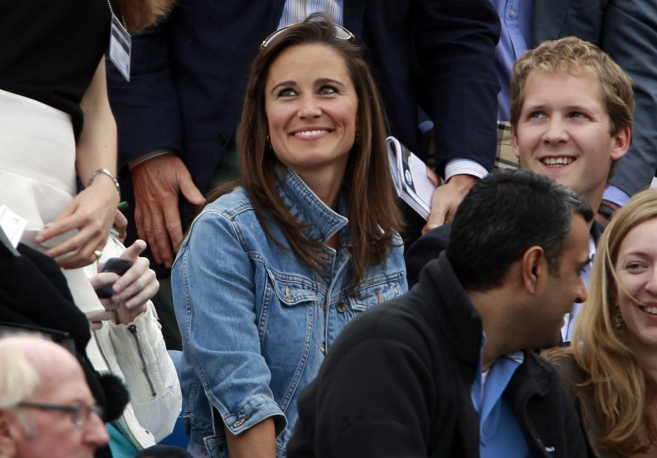 Pippa Middleton (C), sister of Catherine, Britain's Duchess of Cambridge smiles during the match between Andy Murray of Britain and Janko Tipsarevic of Serbia at the Queen's Club Championships in west London June 9, 2011.