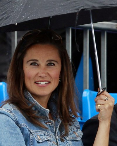 Pippa Middleton, sister of Catherine, Duchess of Cambridge smiles during a rain break at the Queens Club Championships in west London, on June 9, 2011.