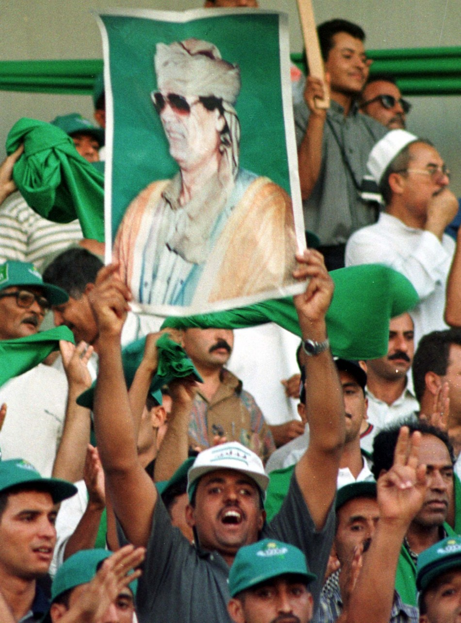 Posters of Libyan leader Muammar Gaddafi held by his supporters