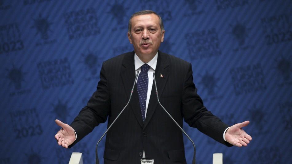 Turkish Prime Minister Erdogan addresses the media at his ruling AKP headquarters in Ankara
