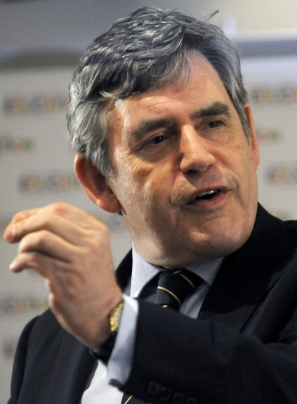 Former British Prime Minister Gordon Brown gestures during a press briefing at the Nelson Mandela foundation after his launch of a new High Level Panel for Education in Soweto