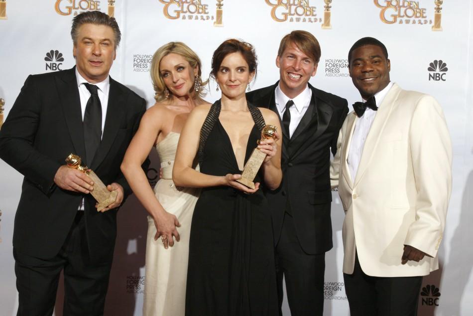 """Cast of """"30 Rock"""" (L-R) Alec Baldwin, Jane Krakowski, Tina Fey, Jack McBrayer and Tracy Morgan pose backstage after their show won the Best Television Series - Musical Or Comedy award at the 66th annual Golden Globe awards in Beverly Hills, Cali"""