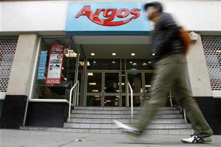 A pedestrian passes a branch of Argos in, central London