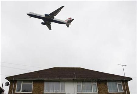 An aircraft makes its final approach before landing at Heathrow Airport in west London