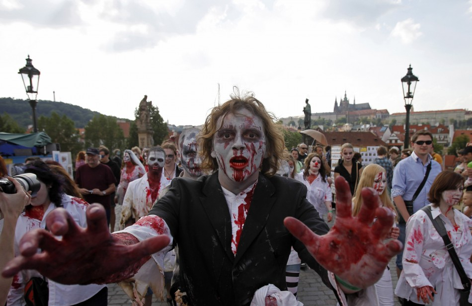 Enthusiasts dressed as zombies march across the medieval Charles Bridge during a Zombie Walk procession in Prague