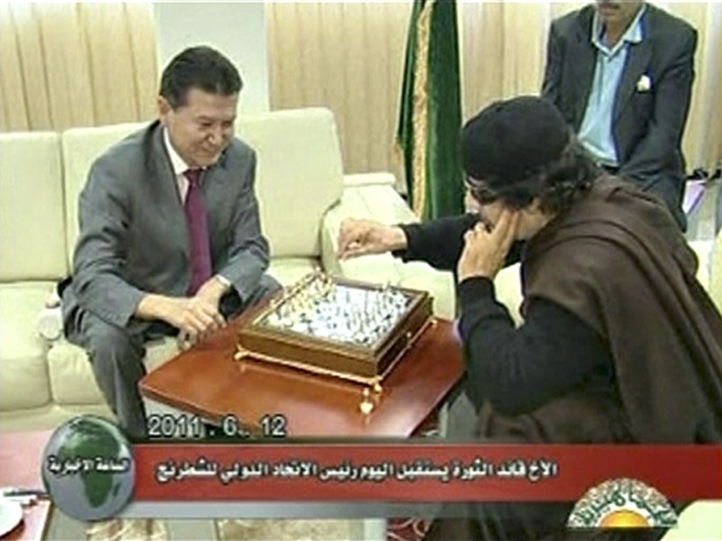 Libyan leader Gaddafi plays chess with Ilyumzhinov, the president of the international chess federation, in Tripoli in this still image taken from video broadcast on Libyan state television