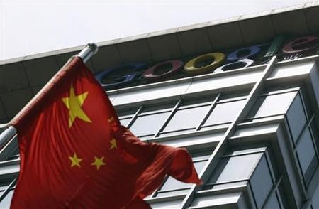A Chinese national flag waves in front of the former headquarters of Google China in Beijing June 2, 2011.