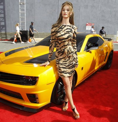 British model Rosie Huntington-Whiteley poses at the 2011 MTV Movie Awards in Los Angeles