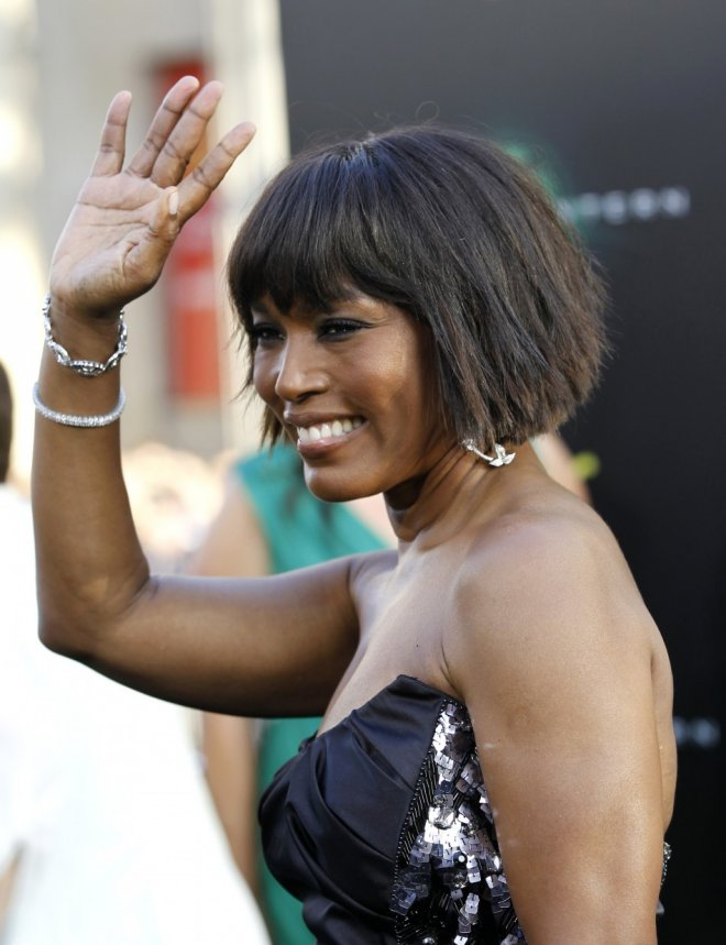 """Cast member Angela Bassett waves at the premiere of """"Green Lantern"""" at the Grauman's Chinese theatre in Hollywood, California June 15, 2011. The movie opens in the U.S. on June 17."""