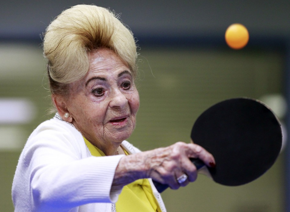 A holocaust survivor plays ping pong at a program for people with Alzheimer's and dementia in Los Angeles