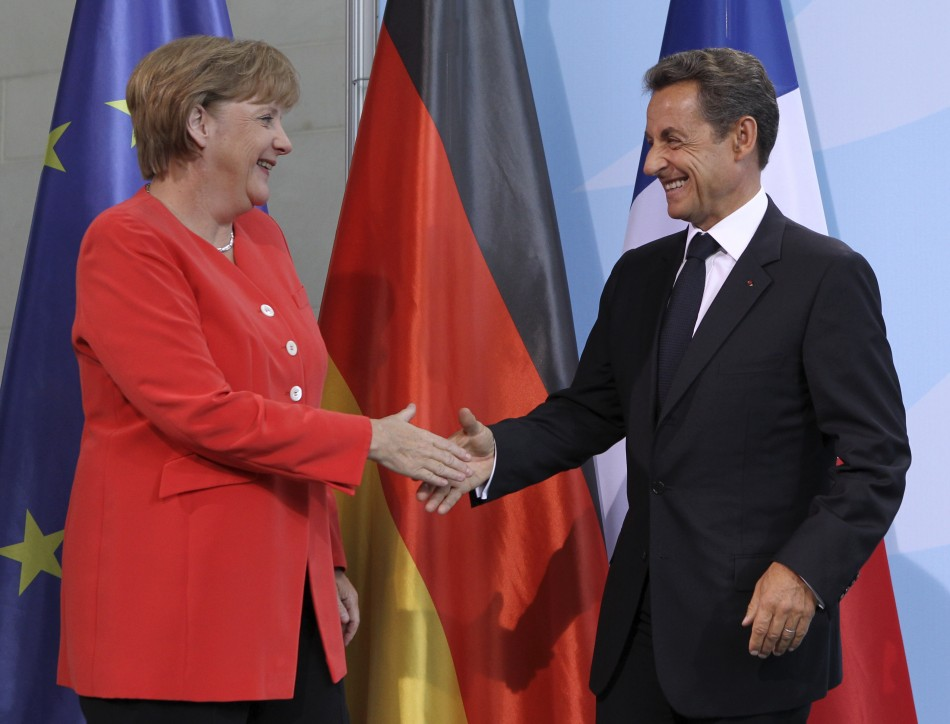 French President Sarkozy and German Chancellor Merkel shake hands after news conference at the Chancellery in Berlin
