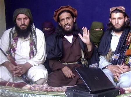In this image taken from a video recording, Omar Khalid Khorasani (C), a top Pakistan Taliban commander, gives an interview in Pakistan's Mohmand tribal region on June 2, 2011.