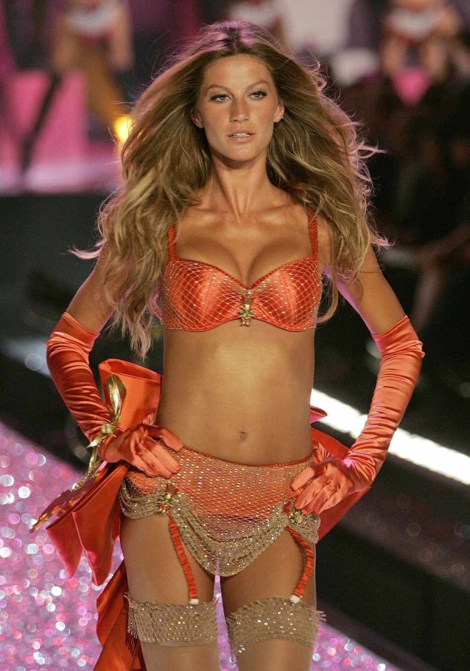 Supermodel Gisele Bundchen poses on the runway during the Victorias Secret Fashion show in New York..
