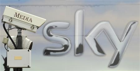 A CCTV camera points past a Sky logo in London
