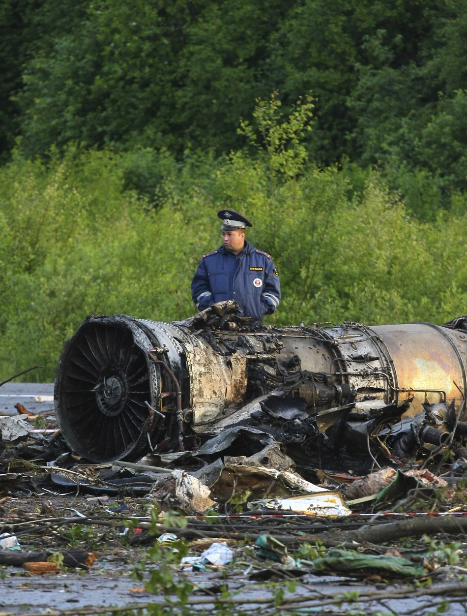 Policeman stands at the site of a plane crash outside Petrozavodsk