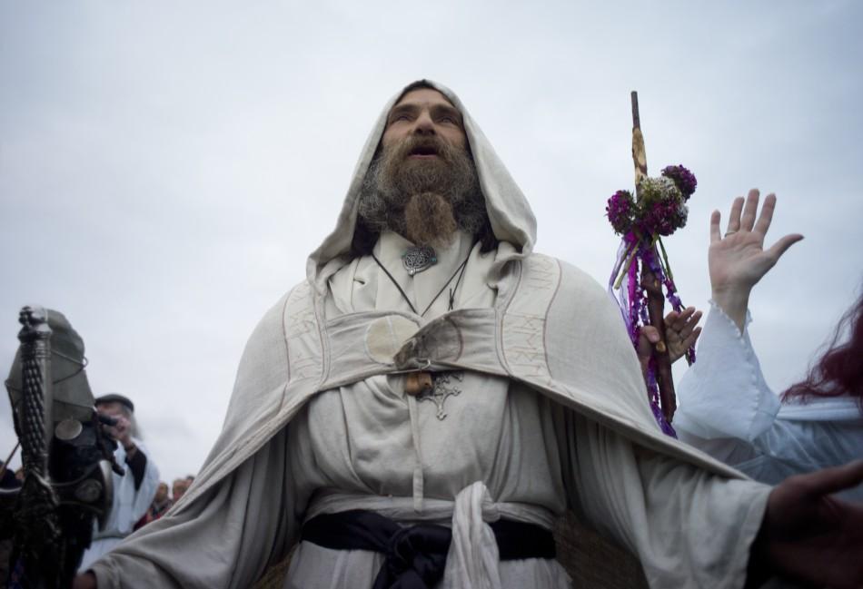 A druid prays at Stonehenge.