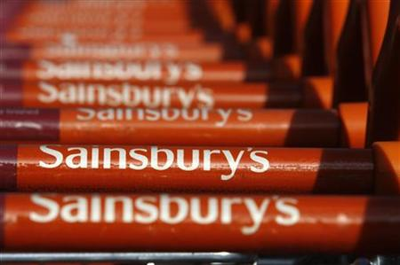 Sainsbury's shopping trolleys are lined up together outside a Sainsbury's supermarket in Brighton