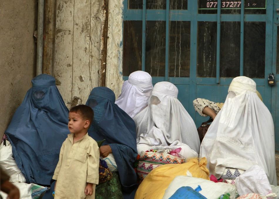 Afghan women wait for transportation in Kabul