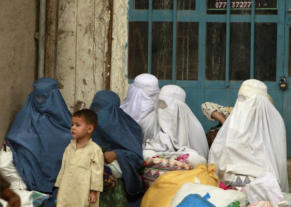 Afghan women wait for transportation in Kabul
