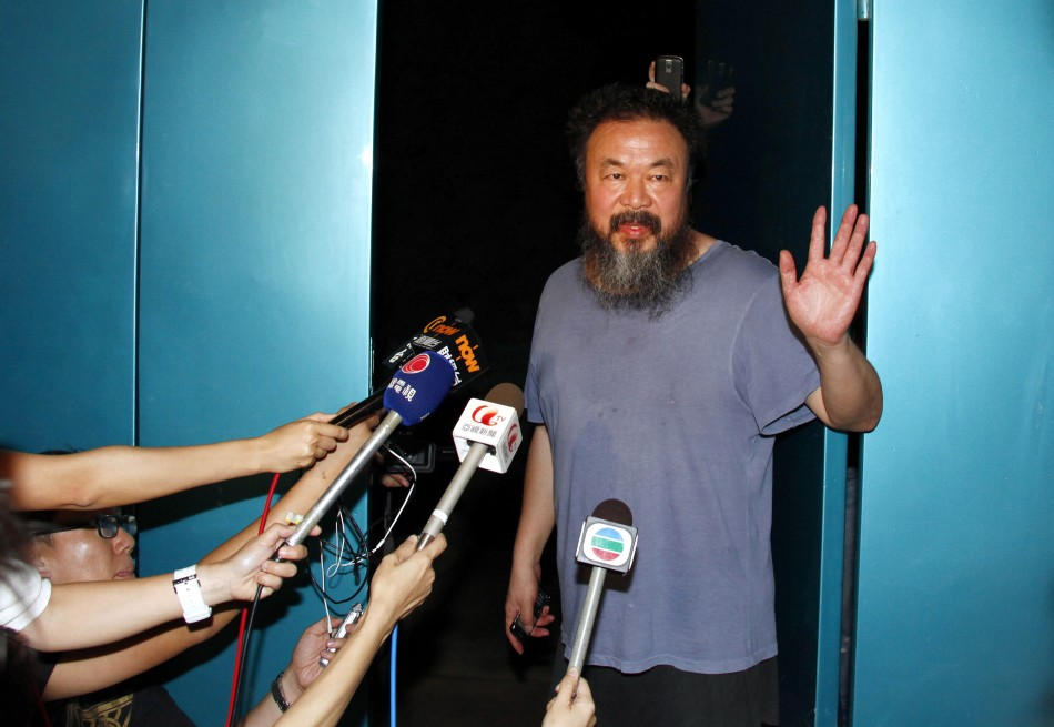 Dissident Chinese artist Ai Weiwei stands in the entrance of his studio after being released on bail in Beijing