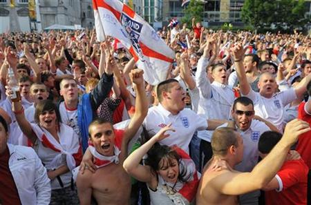 England fans watching on a big screen in Leeds react after a goal is scored during the World Cup soccer match between England and the U.S.