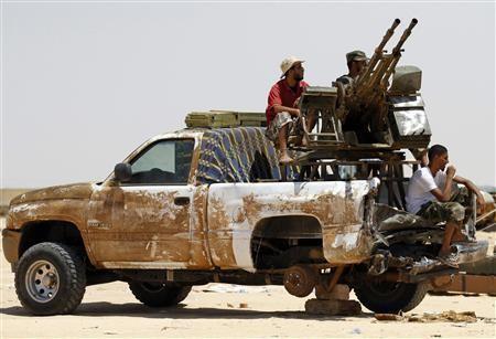 Rebel fighters man an anti-aircraft gun