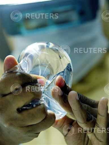 A laboratory worker of Silimed factory checks silicone in Rio de Janeiro, in..