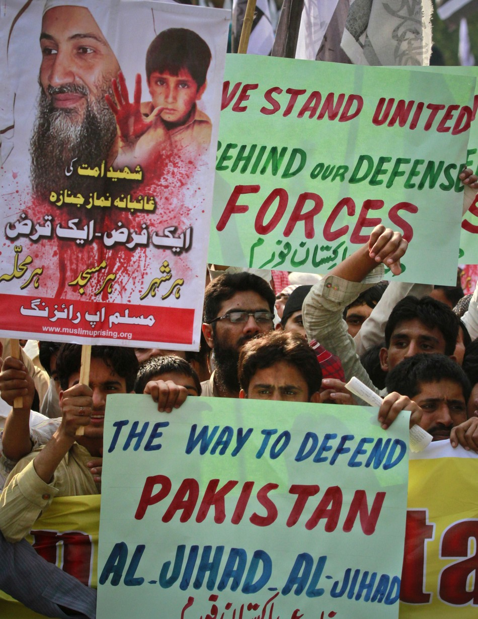 Supporters of the banned Islamic organization Jamaat-ud-Dawa hold placards during a rally in favour of al Qaeda leader Osama bin Laden in Lahore
