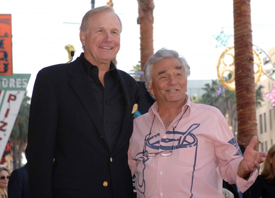 Actors Wayne Rogers (L) and Peter Falk attend the unveiling of Rogers' star on the Hollywood Walk of Fame in Hollywood December 13, 2005.