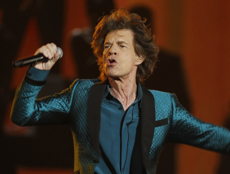 "Mick Jagger performs ""Everybody Needs Someone to Love""at the 53rd annual Grammy Awards in Los Angeles"