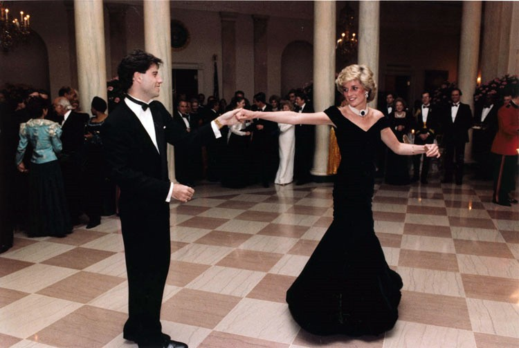 Diana's iconic John Travolta gown fetches $800K at Toronto auction.