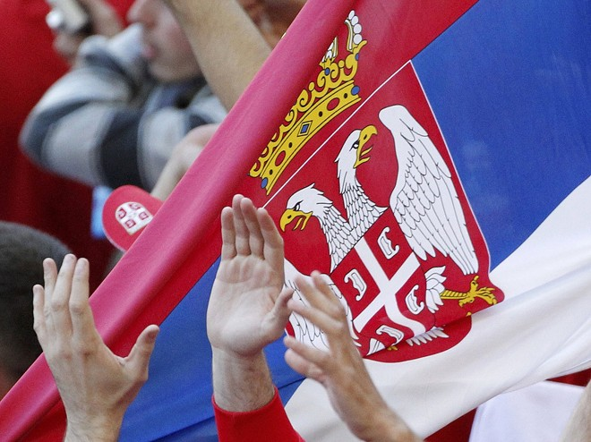 Serbia fans hold up their national flag as they celebrate after defeating Germany in 2010 World Cup Group D soccer match against Serbia in Port Elizabeth