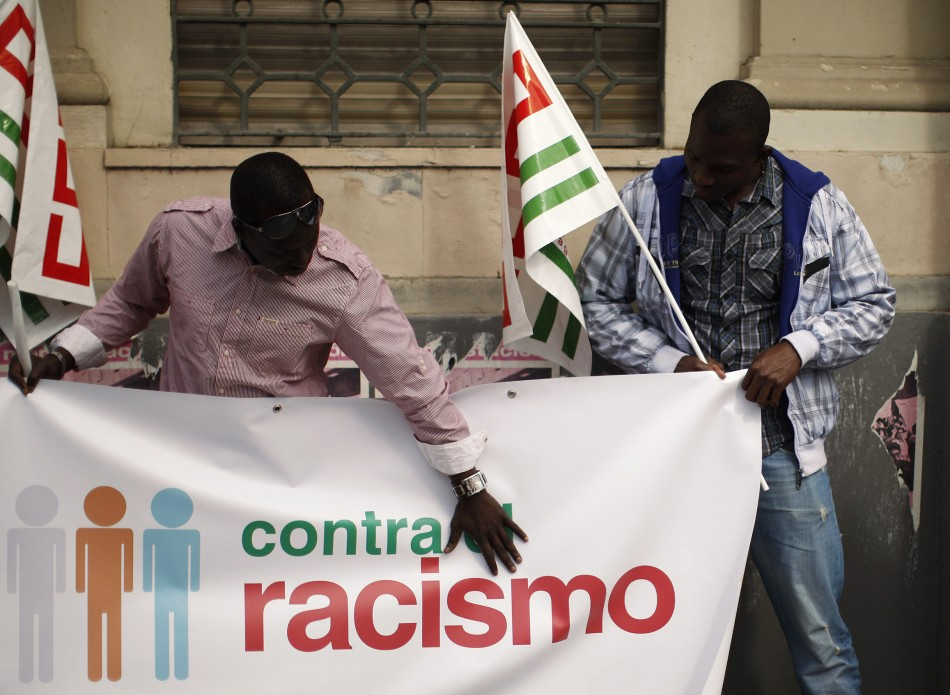 Demonstrators hold CCOO trade union flags while preparing to take part in a May Day rally in Malaga