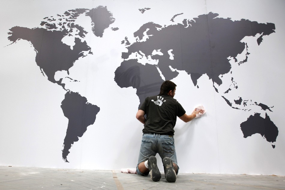 Worker fixes map of the World during final preparations at IAA commercial vehicles trade fair in Hanover