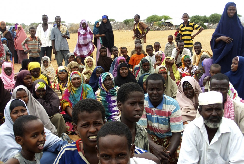 Newly arrived refugees from Somalia gather near at the Hagadera refugee camp in Dadaab, in Kenya's northeastern province