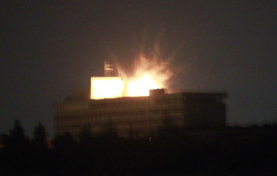 Roof of Intercontinental hotel is lit up by explosion during battle between NATO-led forces and suicide bombers and Taliban insurgents in Kabul