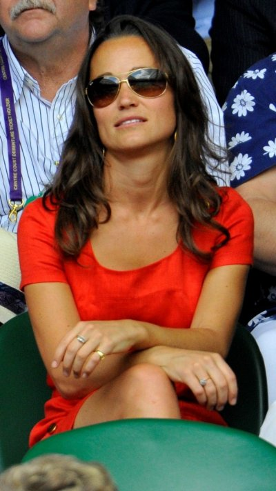 The sister of Catherine, Duchess of Cambridge, Pippa Middleton, sits on Centre Court for the quarter-final match between Jo-Wilfried Tsonga of France and Roger Federer of Switzerland at the Wimbledon tennis championships in London