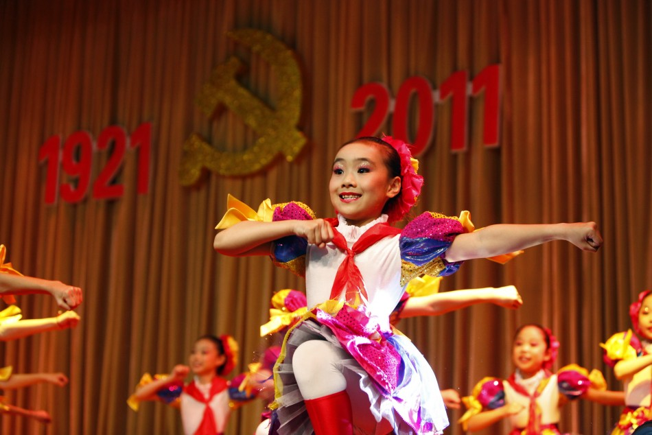 Children perform at a revolutionary song singing event to celebrate the upcoming 90th anniversary of the founding of the Communist Party of China, in Shanghai