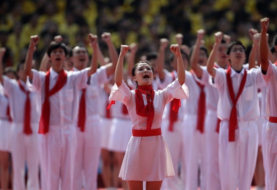 Students perform during the opening ceremony of a revolutionary song singing concert in Chongqing municipality