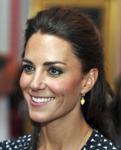 Britains Catherine, Duchess of Cambridge, smiles during an informal reception for young Canadian volunteers in Ottawa