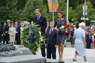 Britains Prince William and his wife Catherine, Duchess of Cambridge visit the National War Memorial in Ottawa