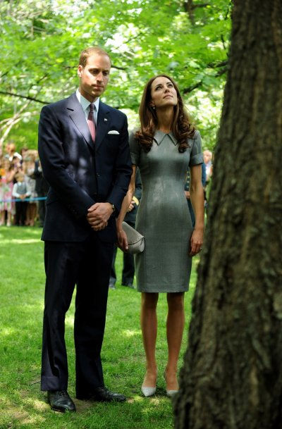 William and Kate quietly reflect at a tree planted by Diana
