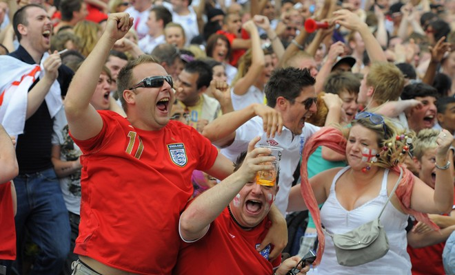 England fans react after a goal while watching the World Cup soccer match between England and Slovenia on a big screen in Leeds