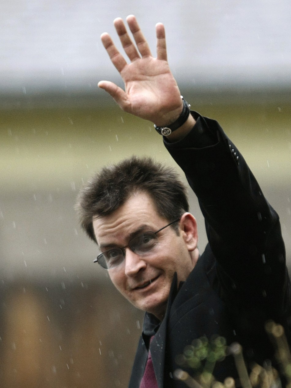 Actor Charlie Sheen gestures toward the media as he leaves the Pitkin County Courthouse after his sentencing hearing in Aspen