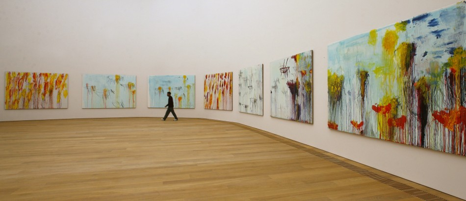 A man walks past the paintings of U.S. artist Cy Twombly in the new Museum Brandhorst modern art museum in Munich