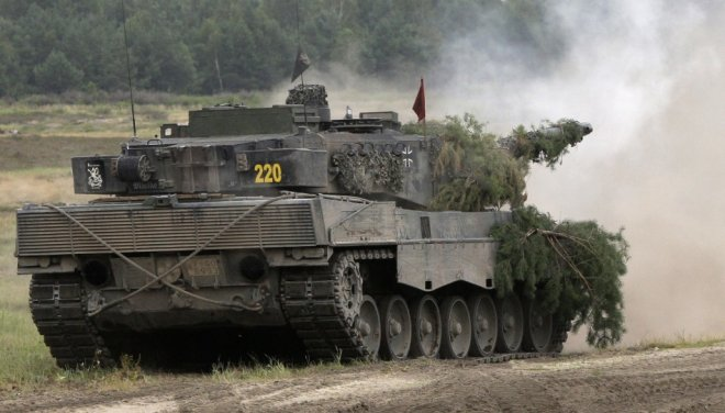 Leopard II battle tank is pictured in action at the Oberlausitz training area in Weisskeissel