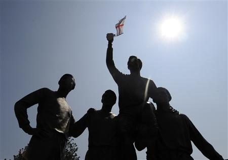 England flag flutters on the statue of soccer captain Bobby Moore and his team mates