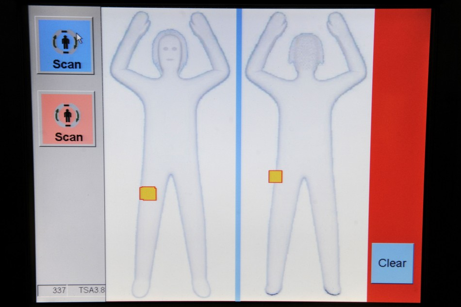 mage of a passenger appears on the screen as Transportation Security Administration employees demonstrate a new body scanner software in Arlington, Virginia